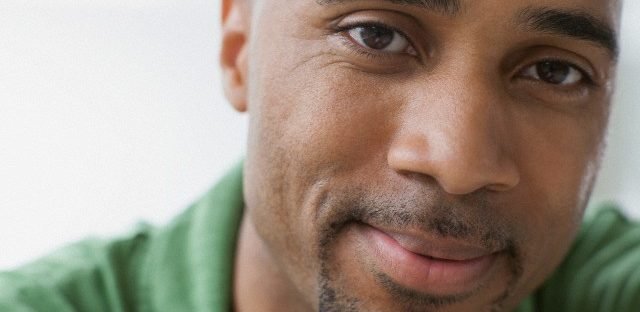 Close-up of African American man with serious look.